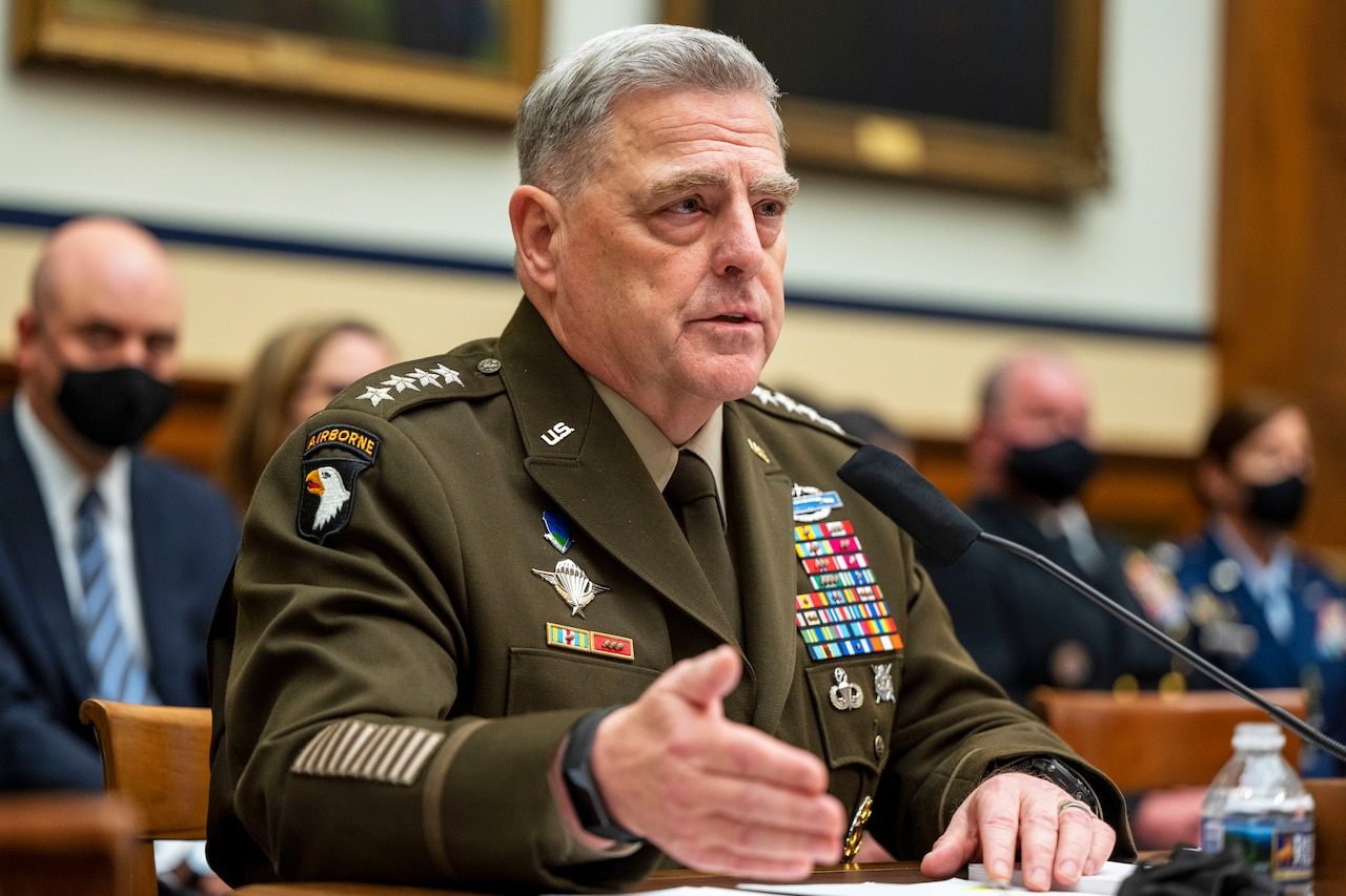 A military officer speaks at a hearing.