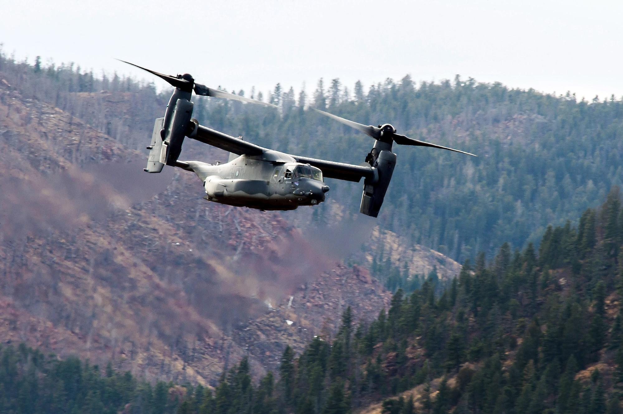 A CV-22 Osprey from Kirtland Air Force Base flies over the U.S. Air Force Academy