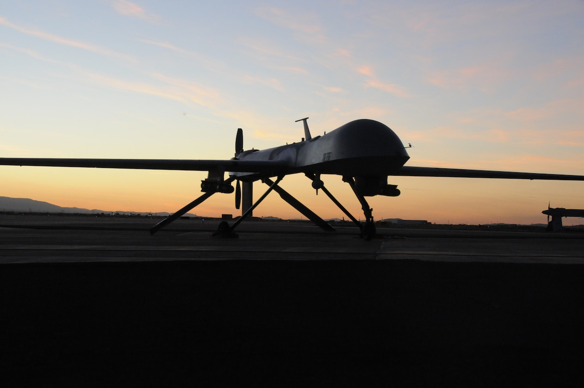 The 163rd Reconnaissance Wing MQ-1 Predator is shown during post flight inspection at dusk