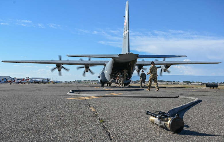 A photo of a plane on the flight line