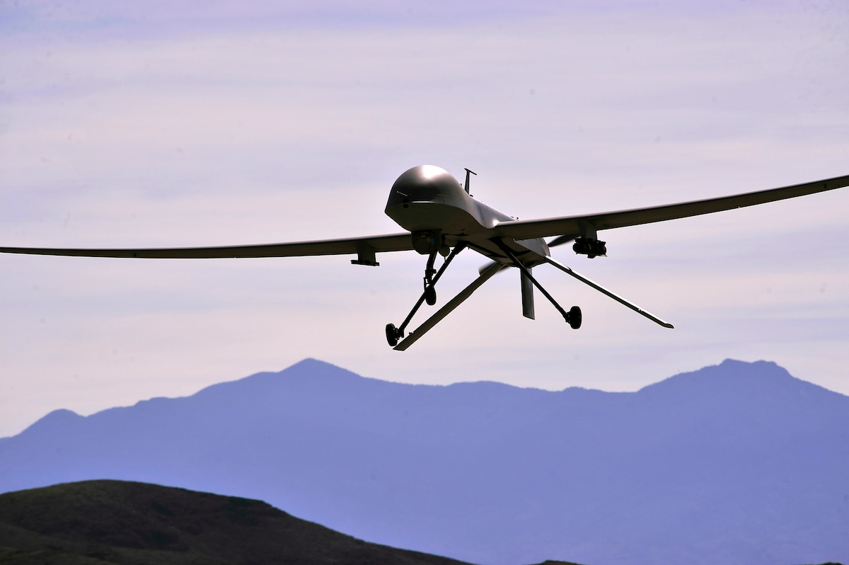 An MQ-1B Predator remotely piloted aircraft passes over the air field during a training mission