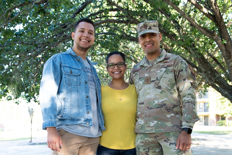 Photo of three people standing together