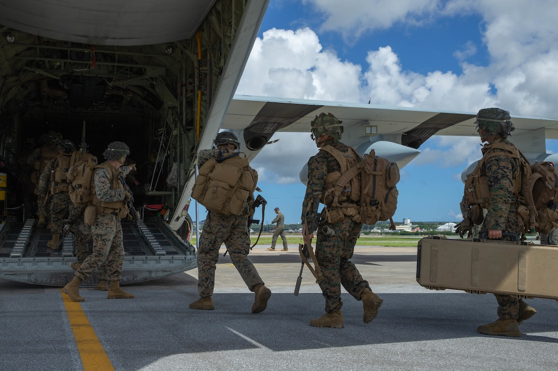 U.S. Marines with 2d Battalion, 3d Marines, 3d Marine Division board a KC-130J Super Hercules with 1st Marine Aircraft Wing while conducting a rapid response drill within the first island chain, Sept. 4, 2021. III Marine Expeditionary Force executed these actions as part of a series of integrated no-notice drills to maintain their high state of readiness and demonstrate U.S. resolve to maintain regional security. The drill refined command and control, communication and coordination of joint fires. 2/3 is forward-deployed under 4th Marines as a part of the Unit Deployment Program. (U.S. Marine Corps photo by Lance Cpl. Scott Aubuchon)