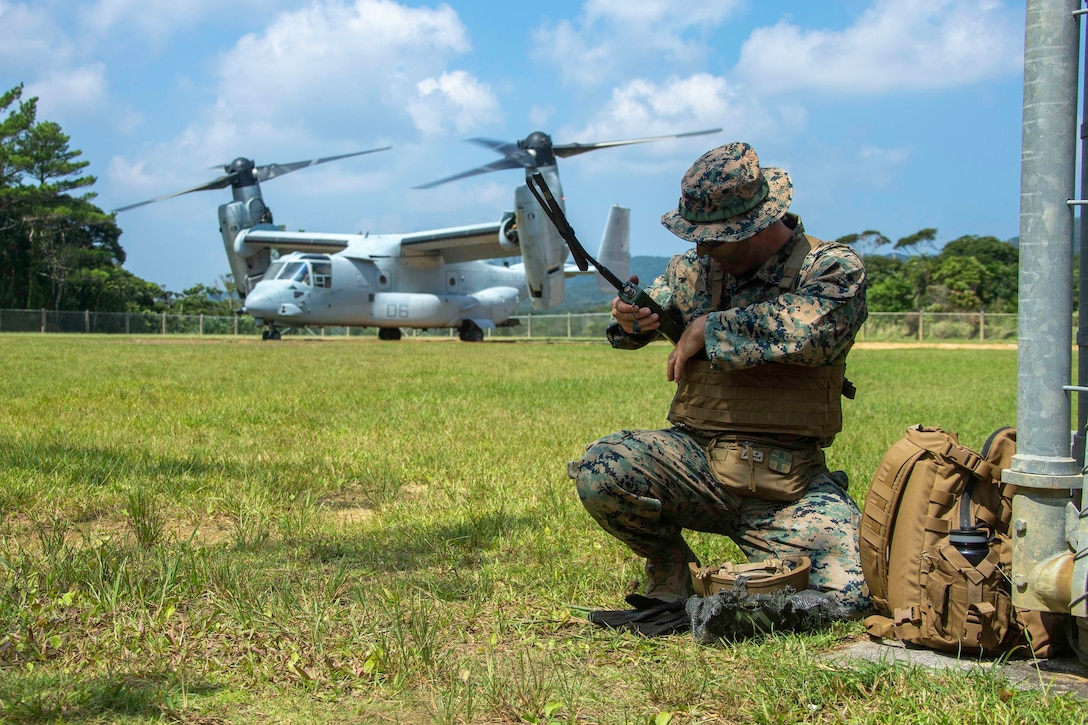 U.S. Marine Corps Staff Sgt. Devon Wheeler, a rifleman assigned to 2d Battalion, 3d Marines, 3d Marine Division, establishes communications during Indo-Pacific Warfighting Exercise in the Northern Training Area on Okinawa, Japan, August 31, 2021. This force-on-force exercise demonstrated the ability to seize and defend key-maritime terrain and provided an opportunity to employ techniques to rapidly establish forward arming and refueling points. 2/3 is currently attached to 4th Marines as a part of the Unit Deployment Program. (U.S. Marine Corps photo by Lance Cpl. Scott Aubuchon)