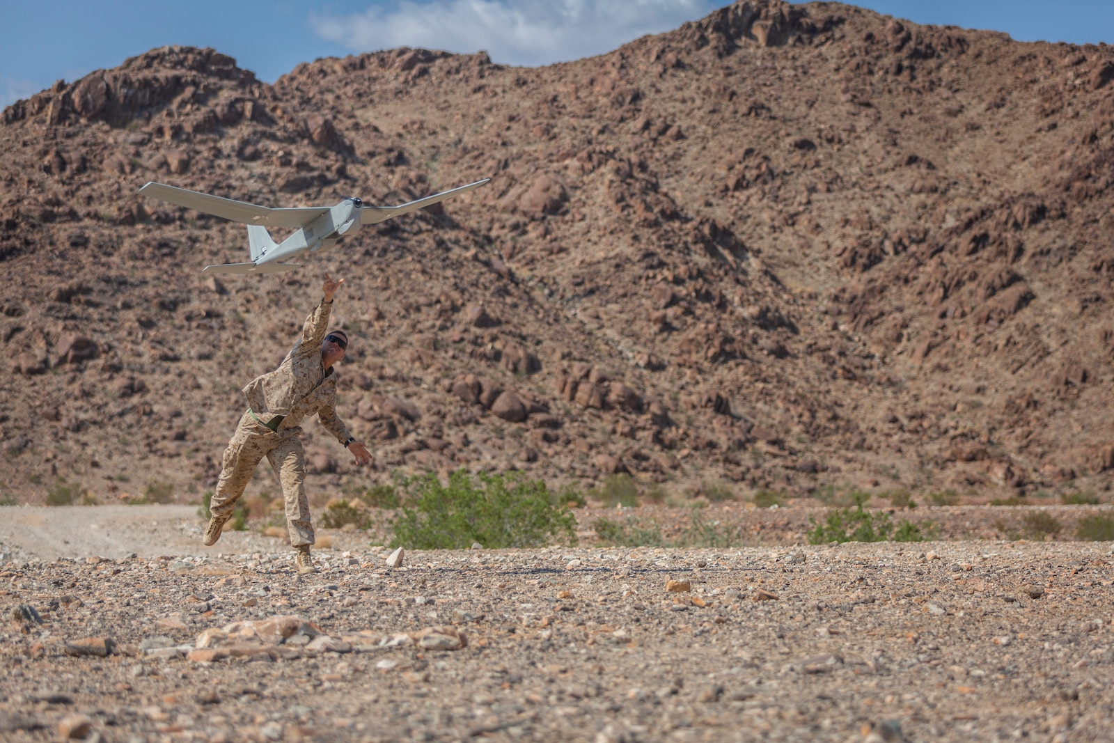 U.S. Marine Corps Cpl. Bruce Stombaugh, an intelligence specialist with 1st Battalion, 3d Marines, launches a RQ-20 puma system as part of Service Level Training Exercise 1-22 at Marine Corps Air Ground Combat Center Twentynine Palms, California, Sept. 24, 2021. New and advanced surveillance systems enhance 3d Marines ability to command and control its forces in an expeditionary and contested environment. Stombaugh is a native of Indianapolis, Indiana. (U.S. Marine Corps photo by Cpl. Alexis Moradian)