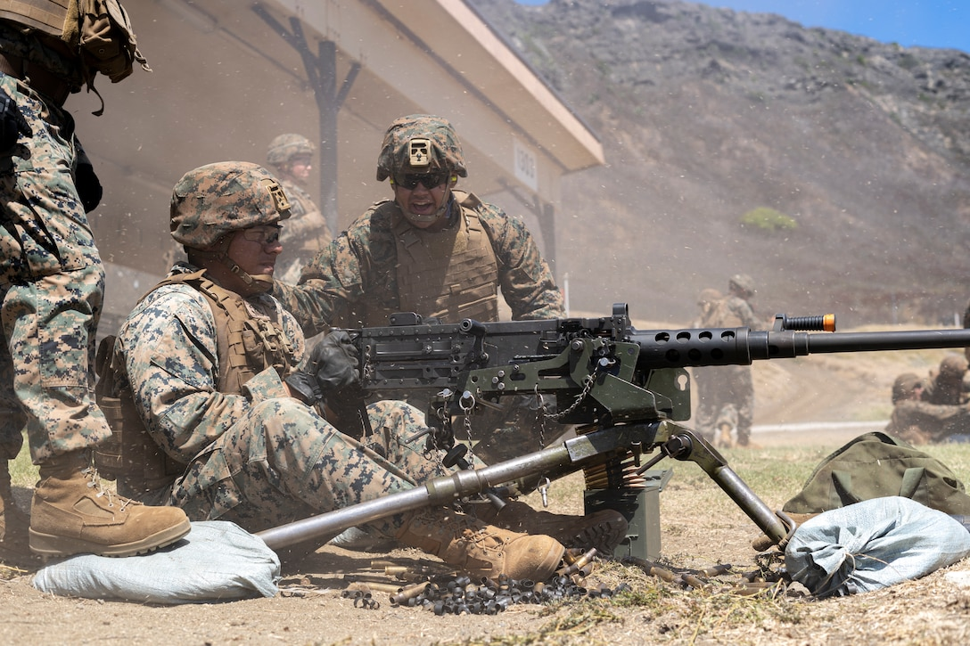 U.S. Marine Corps Lance Cpl. Vena Ahchung, an artilleryman with 1st Battalion, 12th Marines, 3d Marine Division, fires an M2 machine gun during Large Scale Exercise 2021, Marine Corps Base Hawaii, Aug. 4, 2021. LSE 2021 is a live, virtual, and constructive exercise employing integrated command and control, intelligence, surveillance, reconnaissance, and sensors across the joint force to expand battlefield awareness, share targeting data, and conduct long-range precision strikes in support of naval operations in a contested and distributed maritime environment. (U.S. Marine Corps photo by Cpl. Juan Carpanzano)