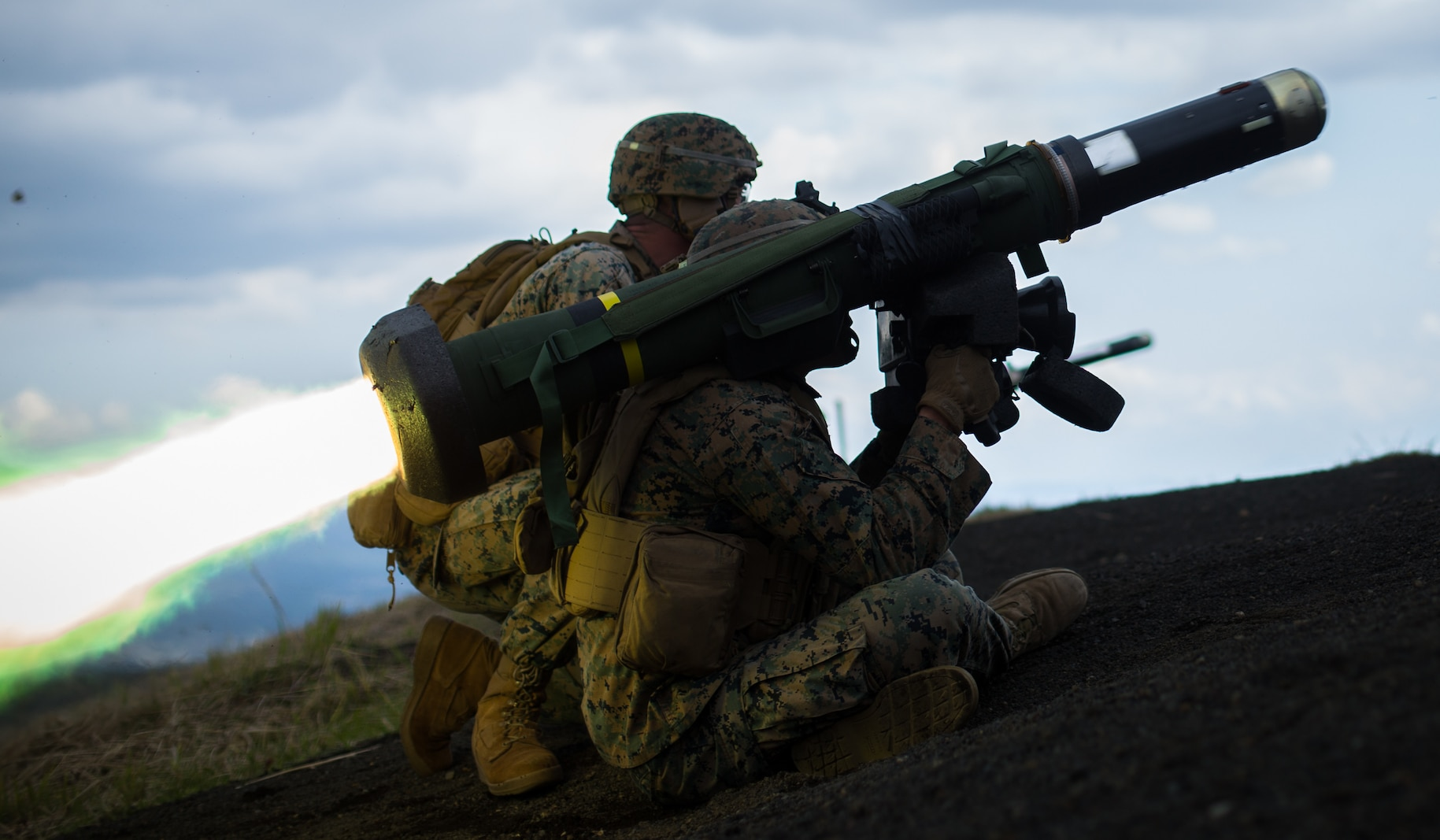 U.S. Marine Corps Lance Cpl. Justin Cooper and Cpl. Jacob Siemsen, anti-tank missile gunners with 3d Battalion, 3d Marines, fire a Javelin missile while conducting a live-fire combat rehearsal during Fuji Viper 21.3 at Combined Arms Training Center, Camp Fuji, Japan, April 12, 2021. During this exercise, Marines honed tactics, techniques, and procedures to support expeditionary advanced base operations at the platoon and company level. 3/3 is forward-deployed in the Indo-Pacific under 4th Marines, 3d Marine Division. Cooper is a native of Old Bridge, New Jersey and Siemsen is a native of Tillamook, Oregon. (U.S. Marine Corps photo by Lance Cpl. Jonathan Willcox)