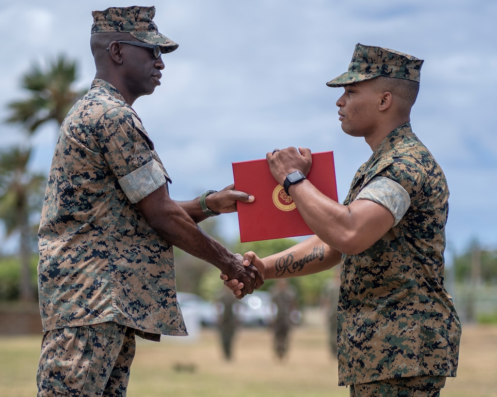 U.S. Marine Corps Lt. Col. George R. Gordy IV, Commanding Officer of 3d Battalion, 3d Marines, awards Lance Cpl. Tercell Byrd, a rifleman with 3d Battalion, 3d Marines, the Navy and Marine Corps Medal, Marine Corps Base Hawaii, June 30, 2021. Byrd received the Navy and Marine Corps Medal for his heroic actions on 28 April 2018. Byrd is a native of Newport News, Virginia. (U.S. Marine Corps photo by Cpl. Juan Carpanzano)