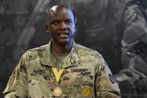 Sgt. Maj. Damien Russell, U.S. Army Financial Management Command Operations senior enlisted advisor, delivers a speech after being presented with the 837th Maj. Gen. Nathan Towson Medallion during a special ceremony at the Maj. Gen. Emmett J. Bean Federal Center in Indianapolis Aug. 26. The Towson Medallion was established by the Army Finance Corps Association on May 7, 1993, and is awarded in recognition of demonstrated exemplary contribution and service to the Army Finance Corps. (U.S. Army photo by Mark R. W. Orders-Woempner)