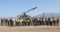 U.S. Army Soldiers from 23rd Brigade Engineer Battalion, 1-2 Stryker Brigade Combat Team, assigned to Joint Base Lewis-McChord, Washington, pose for a group photo at Nervino Helibase in front of a civilian aircraft used to carry supplies to and from fires in support of the Department of Defense wildland firefighting response on the Dixie Fire in Plumas National Forest, California, Sept. 14, 2021. U.S. Army North, U.S. Northern Command's Joint Force Land Component Command remains committed to providing flexible DoD support to the National Interagency Fire Center to respond quickly and effectively to assist our local, state, and federal partners in protecting people, property, and public lands.