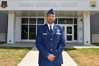 Lt. Col. Ivan Edwards, 433rd Aerospace Medicine Squadron flight surgeon, stands for a photograph at the 433rd Medical Group building on Joint Base San Antonio-Lackland, Texas, Sept. 21, 2021. Edwards emigrated from Uganda to the United States and became a physical medicine and rehabilitation physician. (U.S. Air Force photo by Senior Airman Brittany Wich)