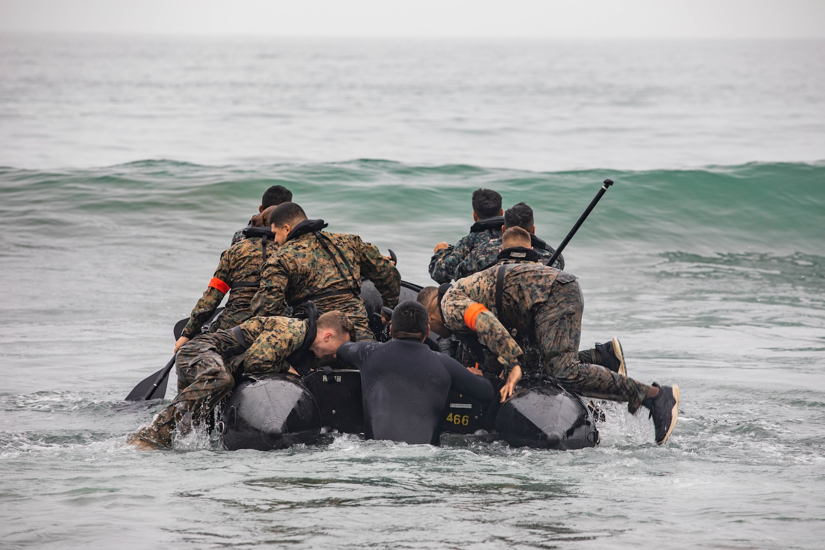 U.S., Brazilian, Chilean, Colombian, Mexican and Peruvian Marines and members of the Jamaican Defense Force utilize a combat rubber raiding craft, at sea, during an amphibious training evolution at the Base de Infanteria de Marina, Peru, Sept. 27, 2021, during exercise UNITAS LXII.