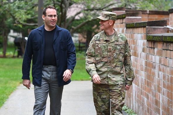 Banshee program participant John Frias, Foreign Military Sales Qatar Air Defense Operations Center program manager and the FMS Division's innovation officer, walks with Capt. Matthew Ruden, chief innovation officer for Program Executive Office Digital, at Hanscom Air Force Base, Mass., Sept. 24.