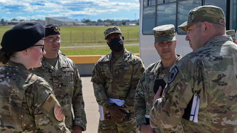 Col. Mark Dmytryszyn, 2nd Bomb Wing commander, converses with Maj. Gen. Andrew Gebara, 8th Air Force and Joint-Global Strike Operations Center commander, and leaders of the 2nd Security Forces Squadron at Barksdale Air Force Base, Louisiana,  Sept. 28, 2021. Gebara visited multiple units during his visit, immersing himself into Barksdale's Stiker Nation. (U.S. Air Force photo by Airman 1st Class Jonathan E. Ramos)