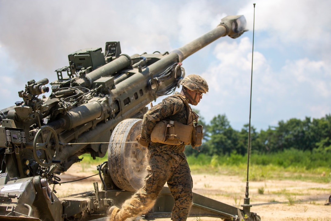 U.S. Marine Corps Lance Cpl. Isaiah Pena, a field artillery cannoneer with 3d Battalion, 12th Marines, 3d Marine Division, fires a M777A2 Howitzer during Artillery Relocation Training Program 21.2 at Ojojihara Maneuver Area, Japan, July 19, 2021. This training contributes to the defense of Japan and the U.S.-Japan Alliance as the cornerstone of peace and security in the Indo-Pacific region. ARTP provides realistic, live-fire training opportunities to the only permanently forward-deployed artillery unit in the Marine Corps, enabling them to provide precision indirect fires from a distributed environment in support of maritime operations. Pena is a native of El Paso, Texas. (U.S. Marine Corps photo by Lance Cpl. Diana Jimenez)