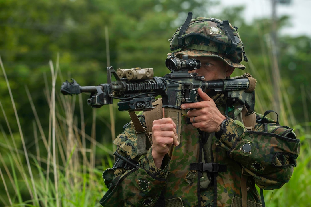 U.S. Marine Corps Sgt. Trever Greer, a rifleman with 2d Battalion, 2d Marines, engages in realistic combat training supported by the Japanese Ground Self-Defense Force Fuji Training Center during exercise Shinka at Combined Arms Training Center, Camp Fuji, Japan June 30, 2021. Shinka and exercises like it exemplify a shared commitment to innovative training that produces lethal, ready, and adaptable, forces capable of decentralized operations across a wide range of missions. 2/2 is forward-deployed in the Indo-Pacific under 4th Marines, 3d Marine Division. Greer is a native of Midland, Texas. (U.S. Marine Corps photo by Lance Cpl. Scott Aubuchon)