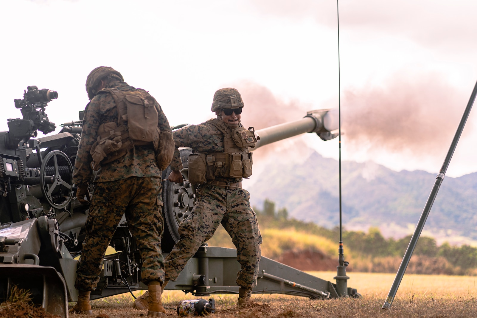 U.S. Marine Cpl. Sergio D. Cano, a motor vehicle operator with 1st Battalion, 12th Marines, fires an M777A2 Howitzer during a live-fire operation on Schofield Barracks, Hawaii, Aug. 31, 2021. 1/12 executes live-fire operations to maintain weapons proficiency and combat readiness. (U.S Marine Corps photo by Cpl. Juan Carpanzano)