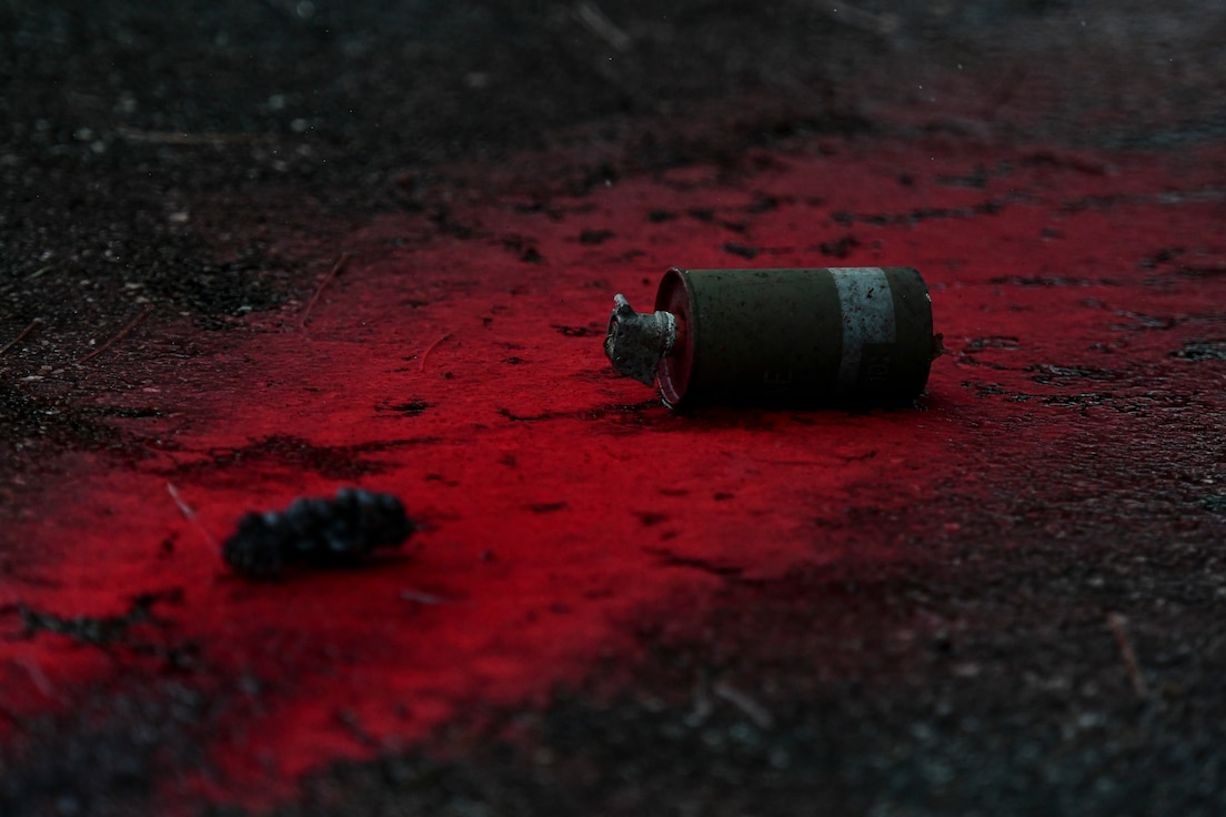 A grenade lays on the ground.