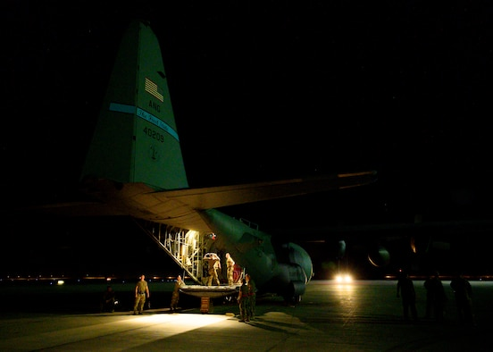 U.S. Air Force personnel load cargo onto a C-130 Hercules on the flightline at Prince Sultan Air Base, Kingdom of Saudi Arabia, prior to takeoff for Al Udeid Air Base, Qatar, Aug. 21, 2021. The 378th Air Expeditionary Wing provided air support, logistics, manpower and resources to U.S. Air Forces Central command in support of the evacuation of American citizens, special immigrant visa applicants and other at-risk individuals from Afghanistan. (U.S. Air Force photo by Senior Airman Samuel Earick)