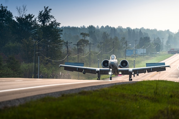 An A-10 Thunderbolt II from Selfridge Air National Guard Base, Michigan prepares to land on a public highway in Alpena, Michigan, August 5, 2021. The highway landing is part of Exercise Northern Strike 21-2, an annual multinational, large scale military training event that tests the rapid insertion of an Air Expeditionary Wing into a bare-base environment. (U.S. Air National Guard photo by Master Sgt. Scott Thompson)