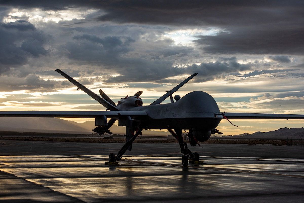 An MQ-9 Reaper sits on the flight line as the sun sets at Creech Air Force Base