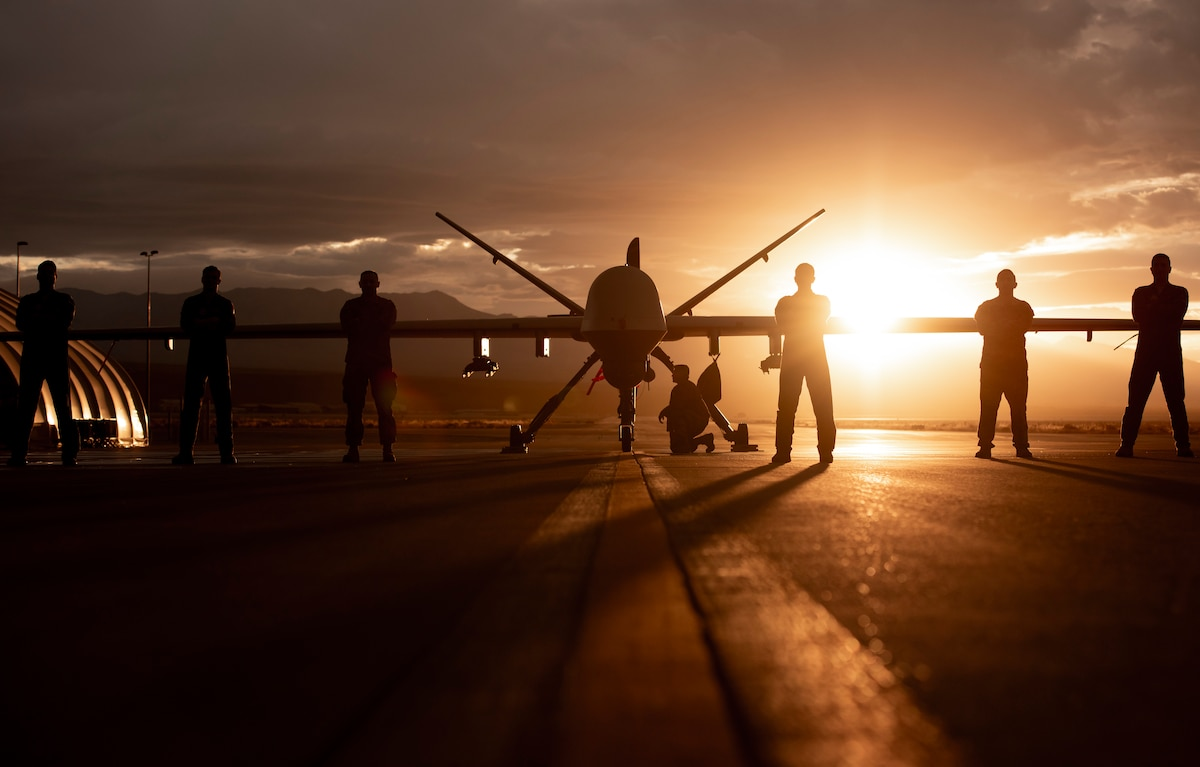 432nd Wing/432nd Air Expeditionary Wing Airmen pose with an MQ-9 Reaper
