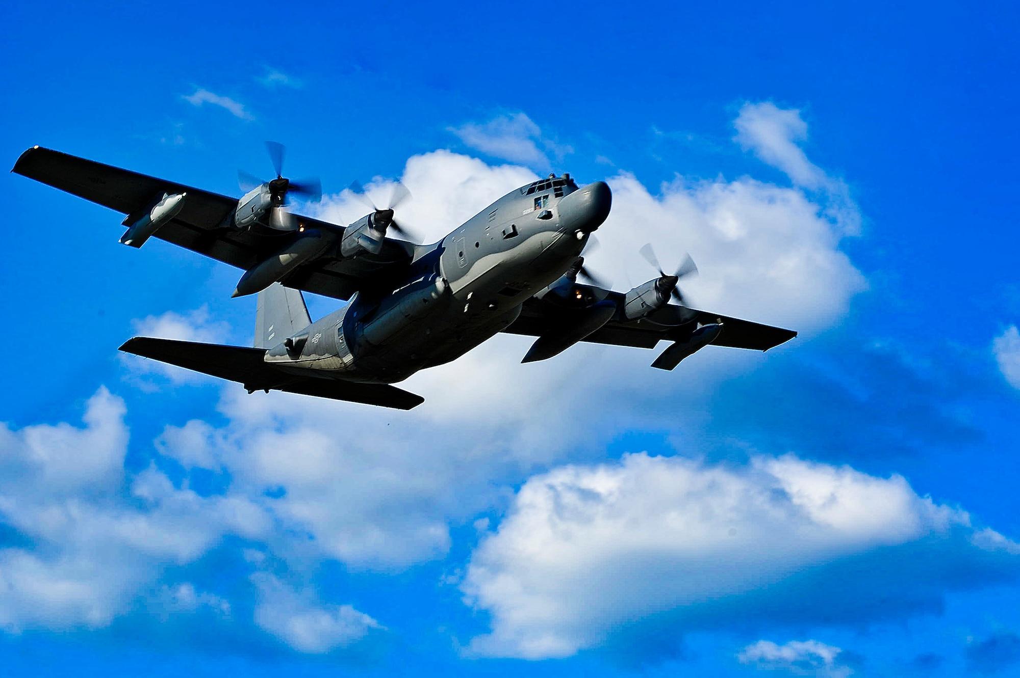 A MC-130H Combat Talon II flies above Hurlburt Field after takeoff.