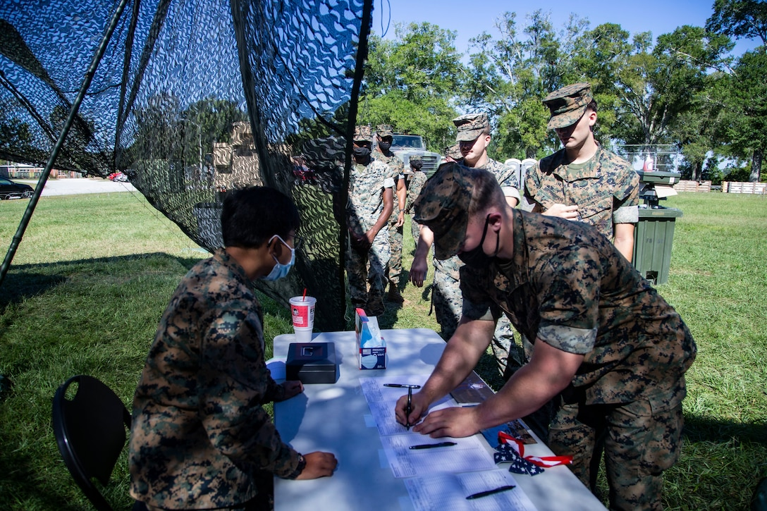 U.S. Marines with II Marine Expeditionary Force Support Battalion, II Marine Expeditionary Information Group (II MIG), sign in during the William P.T. Hill Food Service Competition at Camp Lejeune, North Carolina, Sept. 24, 2021.