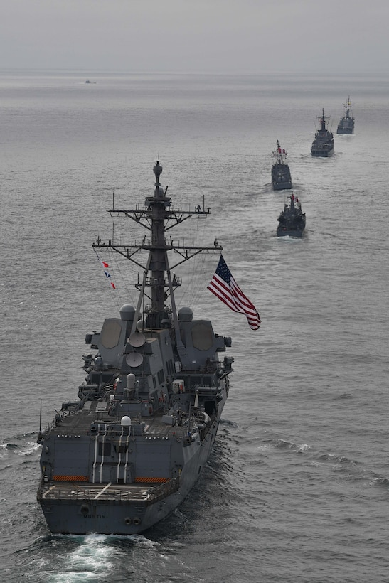 USS Mustin (DDG 89) follows multinational force ships while conducting tactical maneuvers and naval formations during a training exercise as part of UNITAS LXII.