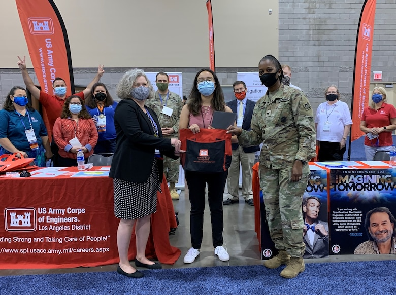 Col. Antoinette Gant, commander of the South Pacific Division, right, along with other Division and District leaders, presents a letter of intent to Anabella Noguera, a senior civil engineering student at the University of California-Los Angeles, during the American Indian Science and Engineering Society National Conference Sept. 24 in Phoenix.