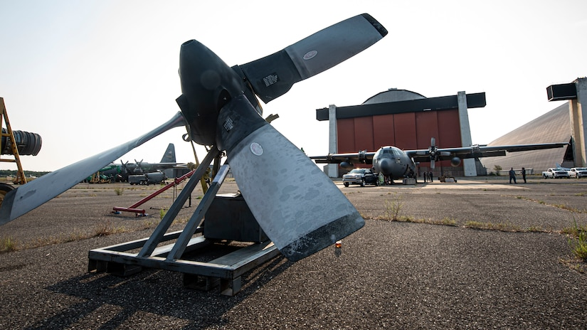 A photo of a C-130 Hercules engine sitting on the flightline.