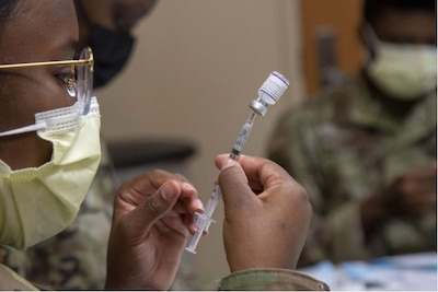 An Airman from the 6th Medical Group (MDG) prepares a COVID-19 vaccine for distribution at MacDill Air Force Base, Florida, Sept. 17, 2021. This is the second time the 6 MDG has established a point of distribution on base in order to help distribute roughly 1,000 COVID-19 vaccines per day. (U.S. Air Force photo by Airman 1st Class Hiram Martinez)