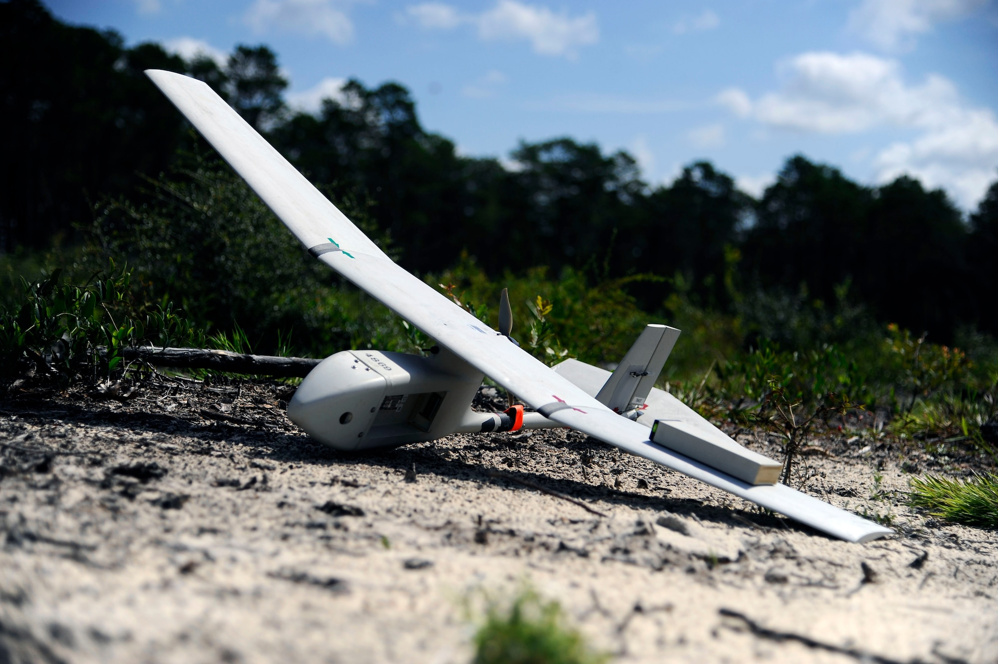 A RQ-11B Raven rests in the dirt