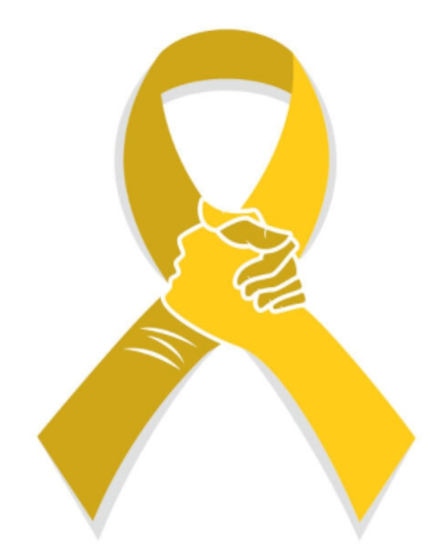 Hands clasp on yellow ribbon.