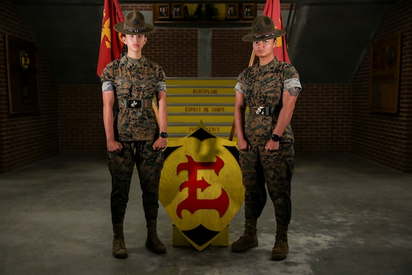 Sergeants Brittany Guadalupe and Adilene Sanchez not only share the bond of being drill instructors together on Parris Island, but also a years-long friendship that dates back to their entry level training at Low Altitude Air Defense School (LAAD).    (U.S. Marine Corps photo by Sgt. Dana Beesley)
