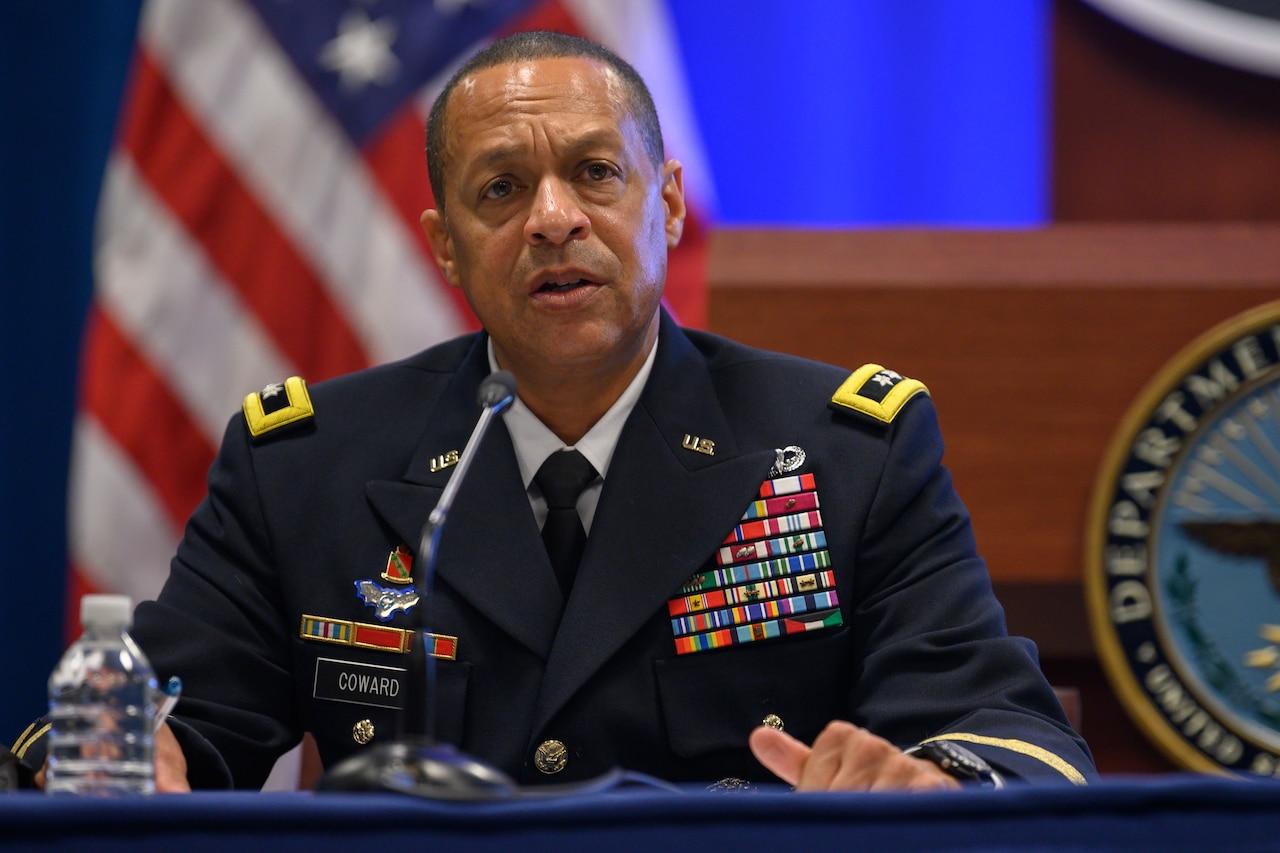 A man in a military uniform speaks.