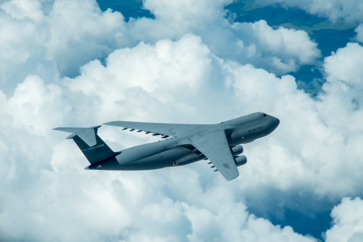A C-5 aircraft flies over disclosed location