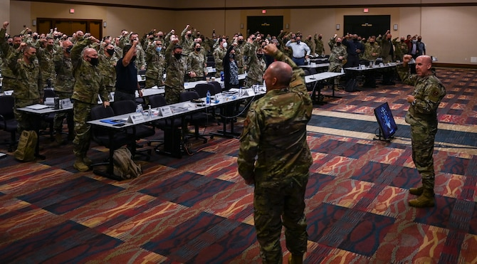 Air Force Recruiters express enthusiasm during their Senior Leader Summit in August.