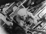 Douglas Munro, climbing ladder photograph